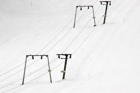 ski lift (T-bar lift) on snowy mountain