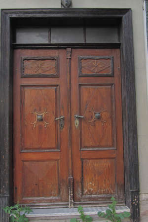 a wooden doubled winged door