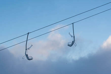 empty chairlift, guest decline in winter tourism