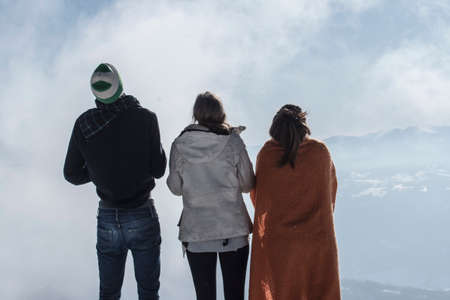 three friends being together on a mountain