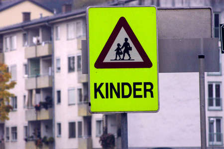 attention school children ('Kinder') sign on the street