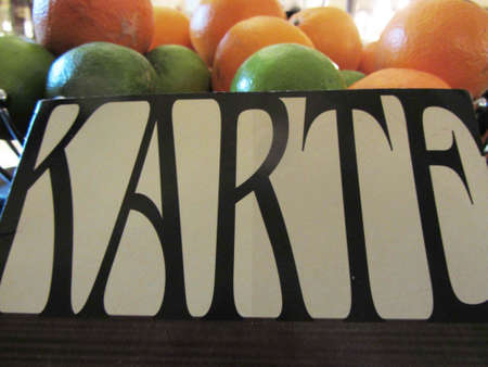 Menu ('Karte') with limes and oranges Stockfoto