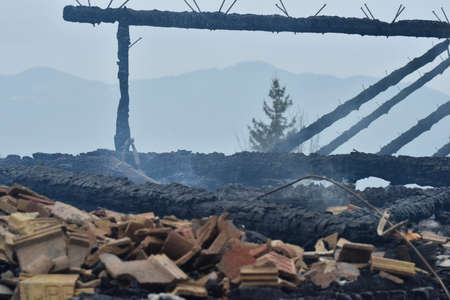 Fire ruin, extinguished fire at a house and charred remains Stockfoto