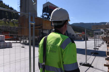 construction worker with safety helmet at constrution site Banco de Imagens