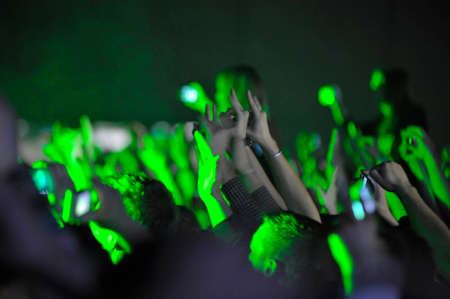 audience at a live concert cheering with hands in the air Reklamní fotografie