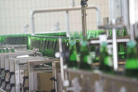 Bottling of mineral water in green bottles, in an industrial plant Reklamní fotografie