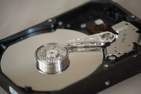 opened hard disk drive, a digital storage medium with mechanical components Фото со стока
