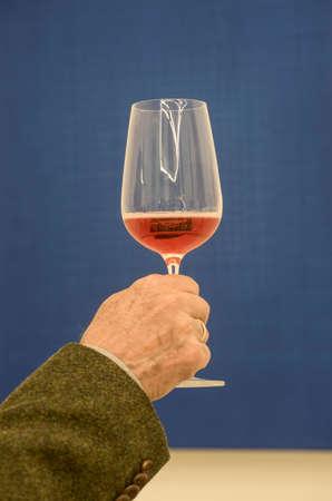 a glass of Schilcher wine, rose wine produced in Styria, Austria