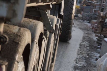 tires of a truck on a muddy road at the construction site