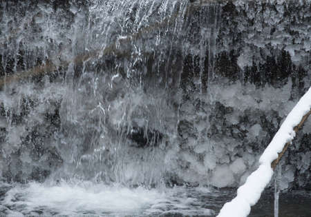 frozen water at a small waterfall in the woods, ice crystals