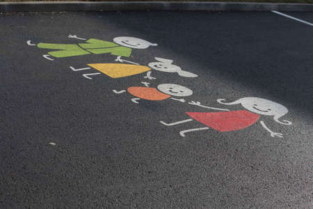 parents with their children symbol, colorful drawing on the street