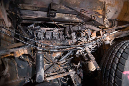 burnt out vehicle after a vehicle fire during the night