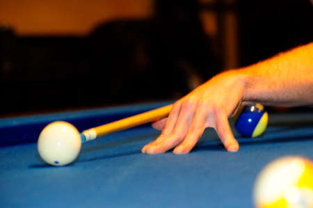 person playing a game of billiard at the pool table 免版税图像