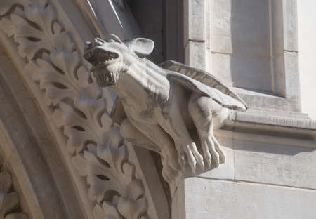 stone statue of a dragon, mythical creature on a building
