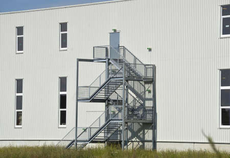 an industrial steel construction, outdoor staircase on the site of a building