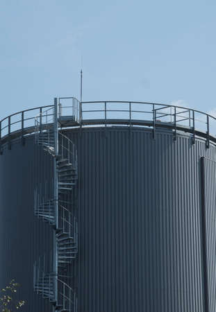 an industrial steel construction, outdoor spiral staircase at a plant Stock Photo