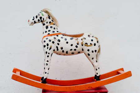 old and used rocking horse, a play toy for children