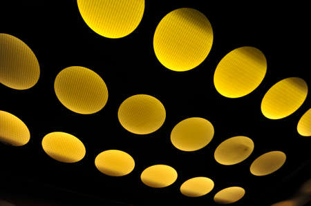 yellow round light spots on black background, interior lighting technology