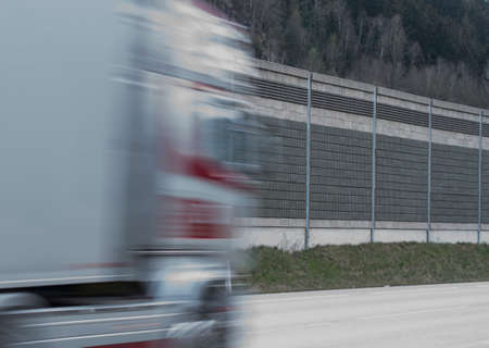 fast moving truck on a country road, cargo traffic on the street