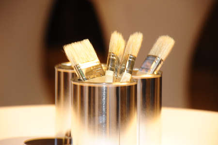 four brushes in a metal container, bright and yellow mood light