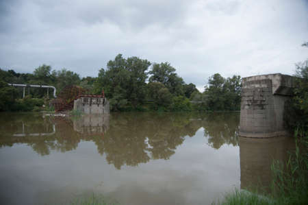 damaged rusty bridge, industrial crisis and economic downturn in Romania