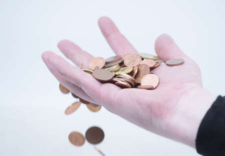 cash transaction hand with coins, cash payment in euro coins