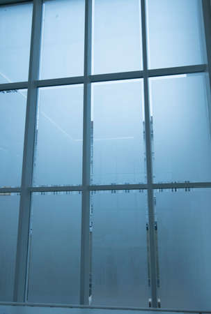 window with frosted glass in a building, blueish cold atmosphere