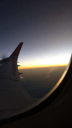 view out of an airplane window at sunset, flight and traveling 版權商用圖片