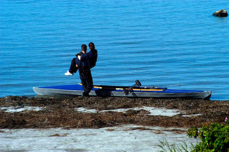 guy carrying his girlfriend to a boat, couple at the water