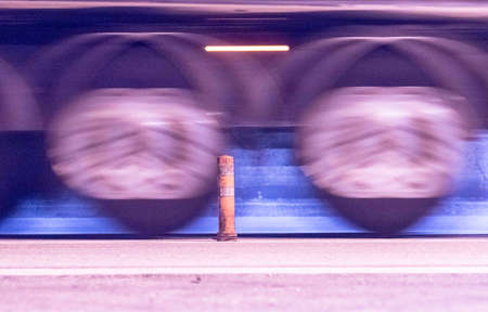 tires of a truck driving by on the street, motion blur