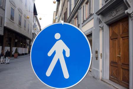 pedestrian traffic sign on the street, blue sign, white pedestrian pictogram