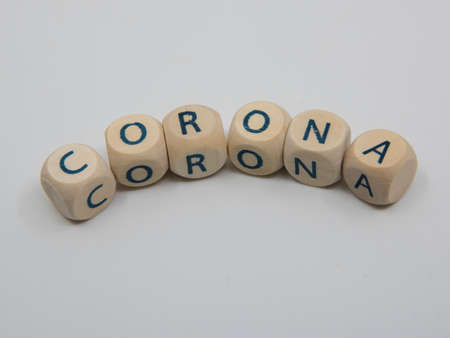 spelling the word corona with small wooden cubes, coronavirus, covid 19