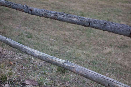 wooden fence as a demarcation to other land and property
