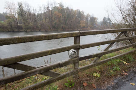 wooden fence as a demarcation to other land and property Stockfoto