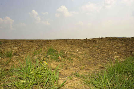 Arable soil and field in spring, agriculture after the end of winter