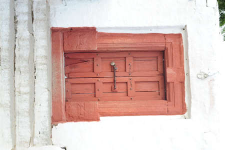 Vintage and wooden door, the entrance to an old building
