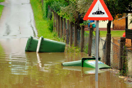 a flooded road after heavy rainfall and thunderstorms took place Stock Photo