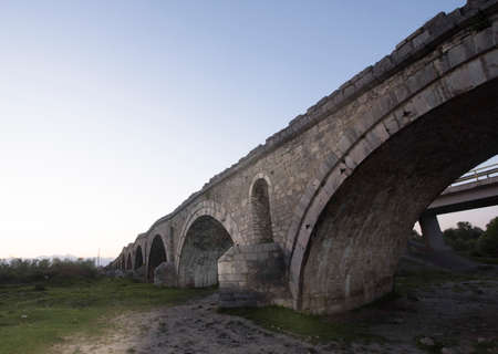 a stone bridge as a structure that crosses natural obstacles for traffic and transport