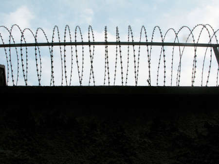 barbed wire as barrier in a prison, measure to prevent outbreaks