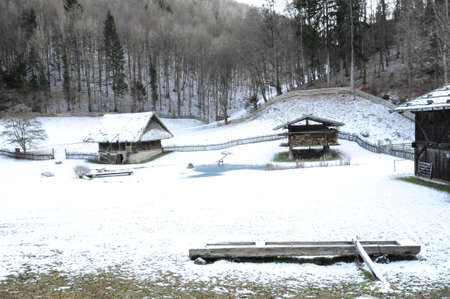 mountain farm and farmhouse in winter, living in the countryside in the mountains