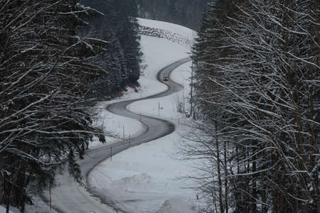 a snowy road in winter, traffic and mobility in winter season