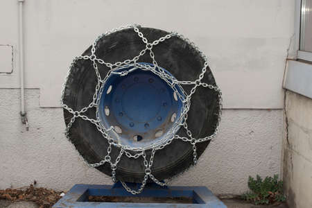 snow chains on a vehicle tire, snow chain obligation in winter