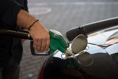 refueling of a car with gasoline at a gas station