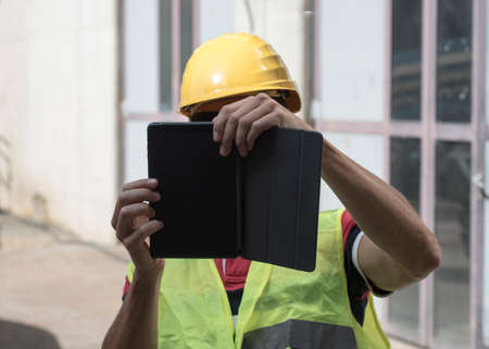 Civil Engineer at building site, working in the construction industry