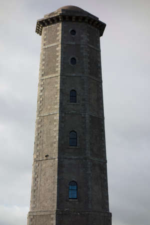 a lighthouse as a navigational aid in shipping traffic and transport in Ireland