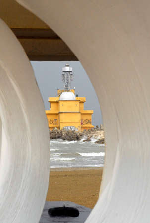 a lighthouse as a navigational aid in shipping traffic and transport in Venice, Italy
