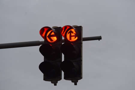 red traffic light signal on the street, symbol for stopping