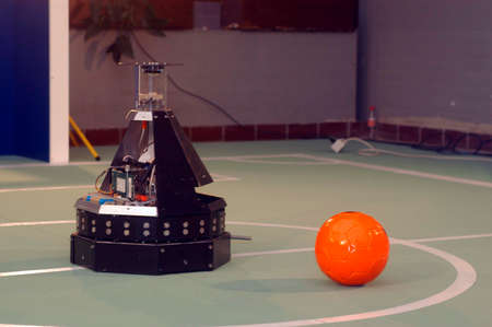 robots competing against each other on a field in a robotics competition