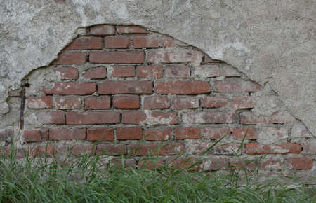 Building damage to a house facade, construction works and repair jobs