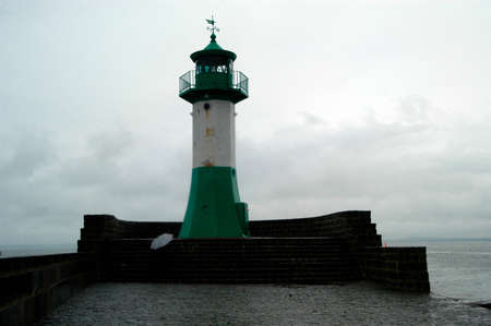 a lighthouse as a navigational aid in shipping traffic and transport